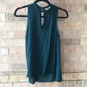 Sleeveless green blouse